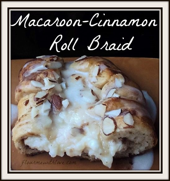 Macaroon-Cinnamon-roll-braid-cinnamon-rolls-wrapped-around-a-coconut-cream-cheese-center,-topped-with-almonds-and-drizzled-with-icing.
