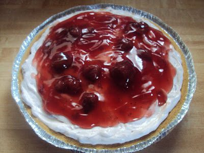 Cream cheese, sour cream, sugar and vanilla are whipped together to make a delicious no-bake cheesecake that is swirled with strawberries!