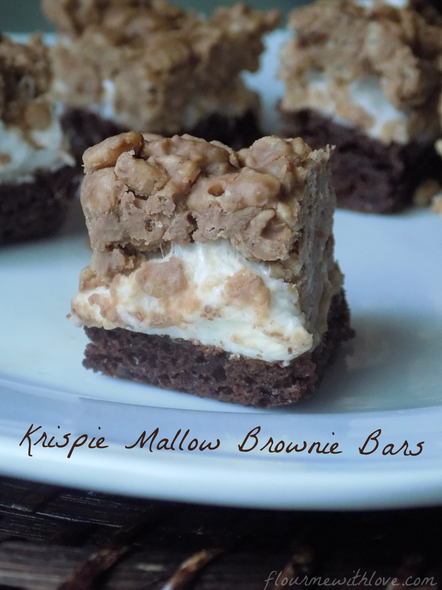 Layers of peanut butter krispie cereal, creamy marshmallows and chewy rich brownies make the perfect bar!